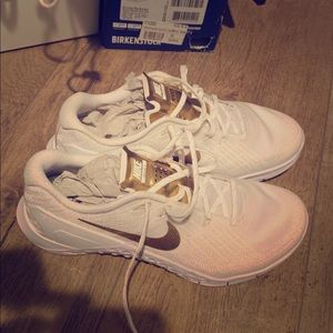White and gold Nike metcons